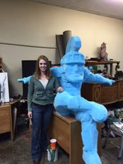 Sculptor Alison Brown stands next to a mock-up of the Sparty statue scheduled to debut later this year inside the MSU Union. Brown has worked on a number of collegiate mascot projects, including for her alma mater Oregon University.