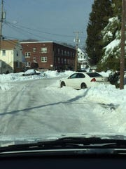Long Branch police warn residents to avoid parking their cars in the middle of the street, blocking snow plows and other traffic.