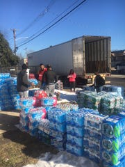 A group of Asbury Park residents collected more than 1,000 cases of water for Flint, Mich.
