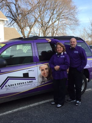Senen Cabalfin (left) and Jeff Wolf own an Executive Care franchise.