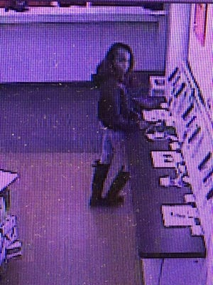 Police are seeking the public's help in identifying this woman, who they say used another person's personal information to open multiple cell phone accounts in Turnersville.