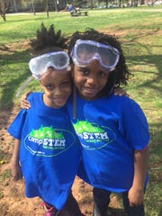 Friends take a break from learning in the lab during Camp STEM at MTSU.