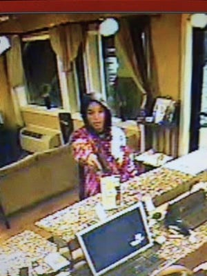 Surveillance photo of armed robbery at Super 8 Motel.