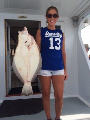 Tina Martinko, Fords, caught this 8-pound fluke aboard the Atlantic Star last summer.