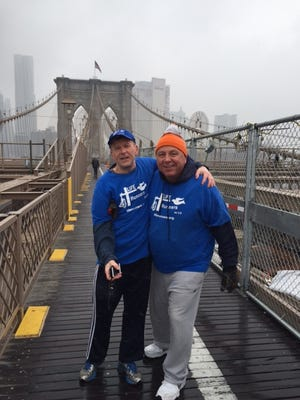 John Byrne from Rockaway and Dan Flaherty from Long Valley, both St. Cecilia's LIFE Runners, on the Brooklyn Bridge.