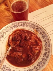 Beef braised with dates, almonds and pomegranate molasses, paired with Hedgerow English-inspired barleywine.