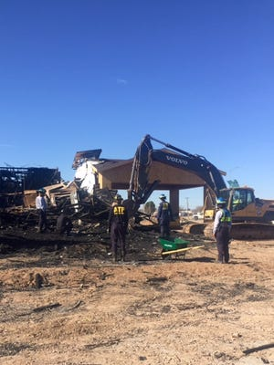 Heavy machinery was brought in to help clear debris to allow investigators access to the remains of a hotel fire.