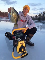 Josh Teigen with a nice crappie he caught inland in