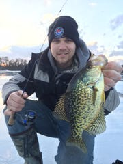 John Dawrwin with a nice late-ice crappie in the Hayward