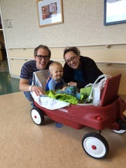 Aiden Lowrance takes a ride at Monroe Carrell Jr. Children's Hospital at Vanderbilt after open-heart surgery. He's joined by his parents, Matt and Magen Lowrance.