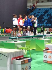 USA Weightlifting's Stephanie Lemmon (second from right) is introduced with other competitors at a weightlifting competition in Rio de Janeiro.