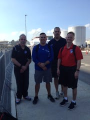 York County's Dr. Mark Lavallee, right, poses with follow USA Weightlifting staff members Peter Roselli (high performance director), Bo Sandoval (men's coach) and Tim Swords (women's coach) outside the Olympic venue in Rio de Janeiro.