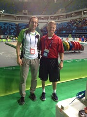 Guilherme Holck, chief medical officer at this weekend's weightlifting competition in Rio de Janeiro, poses with Dr. Mark Lavallee of York County.