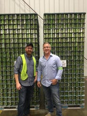 Andrew Bokofsky, left, and Byron Burroughs, Proof's owner, pictured in front of the first patch of canned Proof beer bound for Tallahassee's beer drinkers.