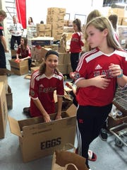 Hawks members pack up boxes of donations from the drive.