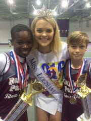 Joshua Marie (left) and Davis Strickland hold their trophies and stand with Miss Louisiana 2016 April Nelson.