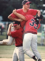 Cliff Brumbaugh is on the top of a William Penn celebration after their 1991 state championship.