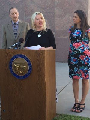 Sen. Debbie Lesko, R-Peoria, announces agreement by the solar industry to withdraw its solar initiative. In exchange, lawmakers will not advance two counter solar measures. With Senate President Andy Biggs, R-Gilbert and solar lobbyist Meghaen Dell'Artino.