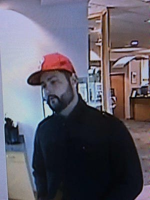 Evesham police released new images of the man they say held up two banks in five days.