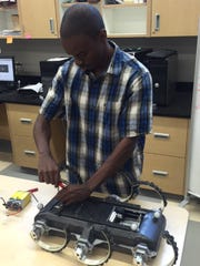 Mechanical Engineering post-doctoral student Brandon Reese working on the XRL hexapedal robot