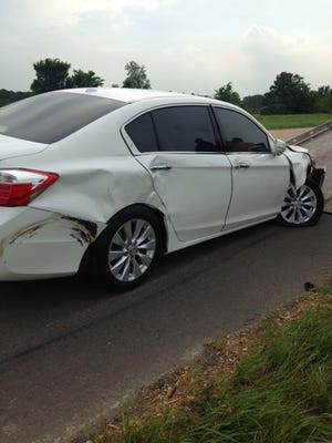 The driver of this 2013 Honda Accord was not injured when a blue Dodge Ram pickup truck hit it on Interstate 49 in Natchitoches Parish on Wednesday. Police are seeking the hit-and-run driver.