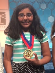 Tara Singh, 11, of Louisville with her finalist medal at the Scripps National Spelling Bee in National Harbor, Md.