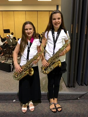 Kaitlyn Bukofsky (left) and Rebecca Howley (right) are pictured at the Cranberry Pines band concert. Kaitlyn got her start on the alto sax after gaining a music scholarship from the nonprofit South Jersey Music Education Partnership to the New Jersey School of Music last summer.