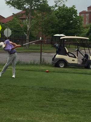 Jeff Peters takes a swing at the New York State boys golf tournament on Monday.