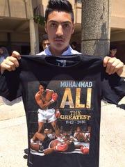 Abdallah Othman, 16, of Fairfield, shows off the tee-shirt