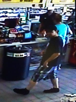 Surprise police are looking for help to identify this man, who is wanted in connection with a fraud case.