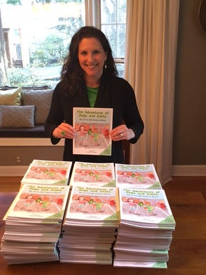 """Gretchen Burman has self-published a book, """"The Adventures of Ooga and Zeeta,"""" designed to help kids manage their emotions and make smart decisions in life."""