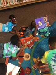 Students read during the Read to be Ready program this summer at Alexander Elementary School.
