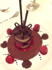 The Green Room's signature, showstopping dessert ($10), made by pastry chef Michele Mitchell, is amaretto white chocolate raspberry Napoleon or thin layers of dark chocolate between white chocolate amaretto mousse with fresh raspberries and berry coulis.