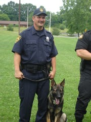 Officer Raymond Marino with Robbie during canine school graduation on June 12, 2009.