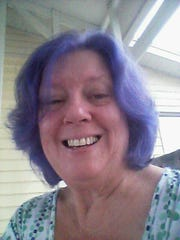 """Karen Young dyed her hair purple """"to spite the cancer."""""""