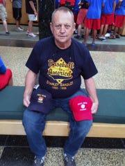 Don Wilson of Waynesboro displays the caps representing