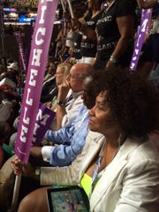 Alabama state Sen. Linda Coleman-Madison of Birmingham listens to first lady Michelle Obama at the Democratic National Convention in Philadelphia, July 25, 2016.