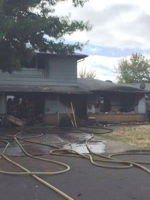 A two-alarm fire at a duplex east of Salem displaced 14 people Tuesday morning.