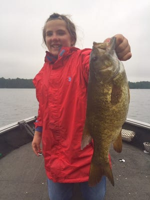Morgan Evans with a big smallmouth bass caught in the Hayward area.