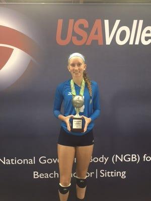 Newark Catholic sophomore-to-be Samantha Basham poses with her 15U national runnerup trophy at Indianapolis.