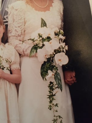 This is a photograph of the missing wedding dress, which Karen Manning wore in 1998.  She is hopeful someone has the dress and will return it to her.