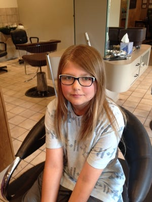 Madison Cornell got her hair cut at Fashion Villa Hair Salon, Rothschild,  and donated it to Locks of Love.