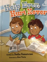 "The cover of ""Help Ever, Hurt Never,"" one of Sudha Ramaswami's educational picture books."