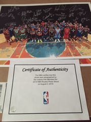 Up for auction at Bill Paden's Poughkeepsie charity event, a photo of the 2014 NBA draft class, signed by the players.