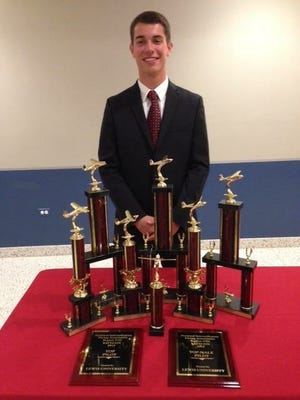 George Nimmer poses with his collection of awards and trophies after a highly successful collegiate competitive flying career, in part thanks to local Sheboygan aviation resources.
