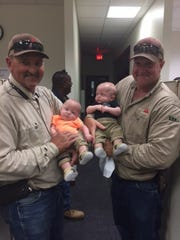 The healthy twins visited Kelley's office and her coworkers who supported her through her ordeal. Pine Forest lineworkers Ray Scruggs, holds Asher, and Ron Anthony, holds Cayson.