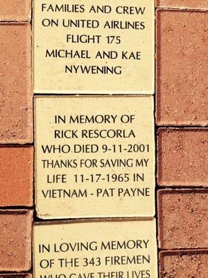 A paver at the Freedom Memorial recalls Rick Rescorla.