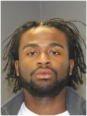 Charles Lewis Jr. was arrested in Lansing on Friday, Sept. 16, 2016.