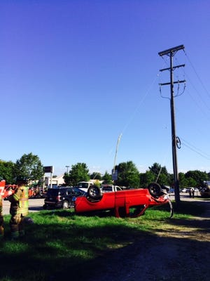 A 22-year-old woman was hospitalized after a two-vehicle crash in Canton.
