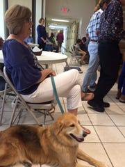 Natalia Contreras/Caller-Times Gayle Gottlich sat next to her dog, Chance, during a special service and pet blessing Sunday at All Saints Episcopal Church.